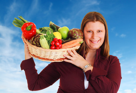 glut: Girl with a basket full of vegetables