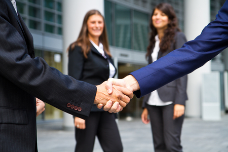 associates: Business handshake and business people Stock Photo