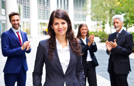 business casual: Business team celebrating a success of a colleague