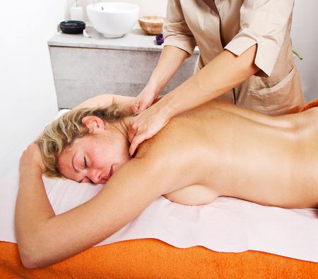 beauty center: Relaxed woman having a massage in a beauty center