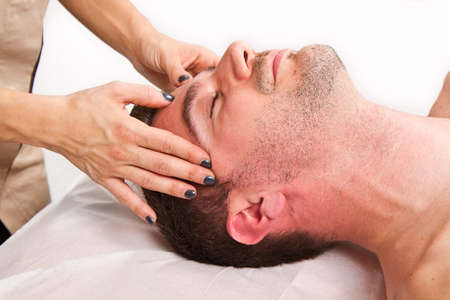male massage: Man getting massage in thebeauty center