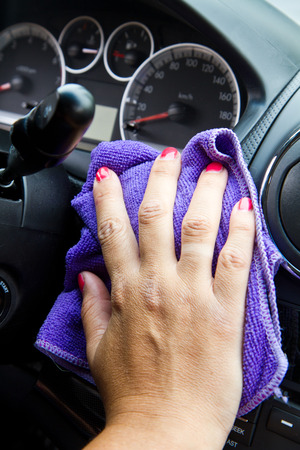microfiber cloth: Womans hand with microfiber cloth polishing  a car