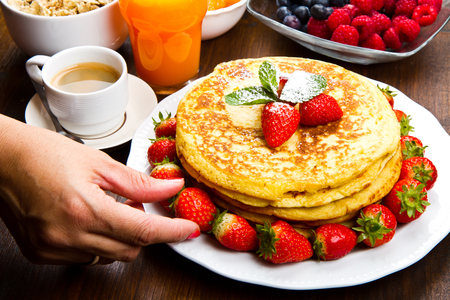 jarabe: stack of freshly prepared traditional pancakes with strawberries