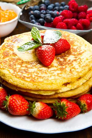 freshly prepared: stack of freshly prepared traditional pancakes with strawberries