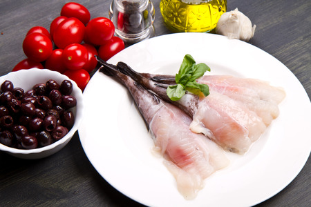 tails: Fresh fish monkfish with ingredients