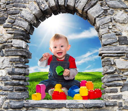 baby playing: stone windows with baby boy playing with soft bricks