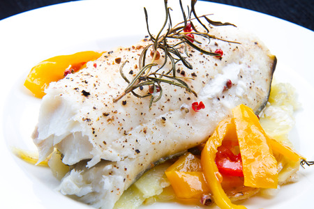 cod oil: white baked cod with pepper and rosemary Stock Photo
