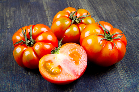 beefsteak: Beefsteak tomatoes, isolated on wood