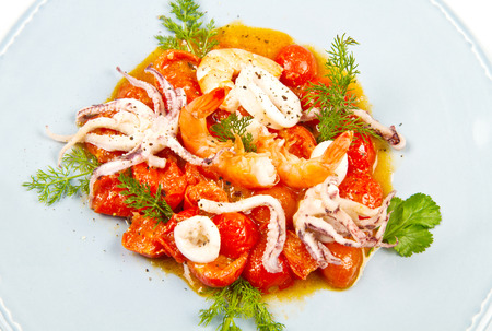 seafood soup: seafood soup with tomatoes and squid Stock Photo