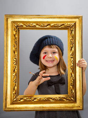 looking through frame: little painter girl  looking through a vintage picture frame