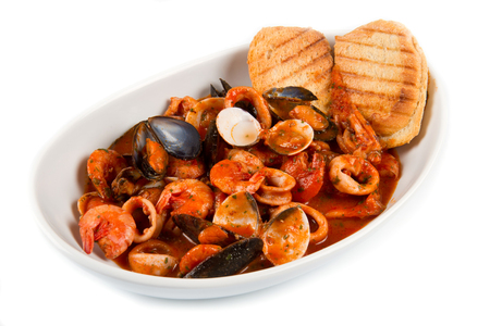 seafood soup: fresh seafood soup with roasted bread