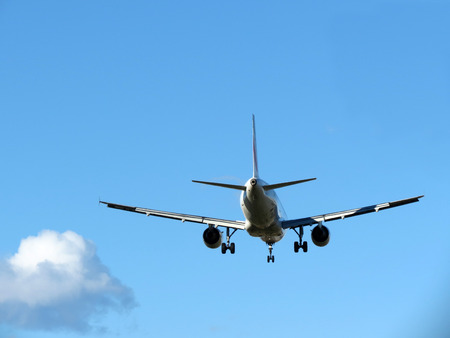 heavy: airplane taking off, against blue sky