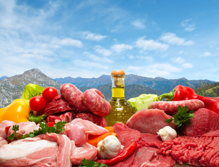 assortment: Fresh butcher cut meat assortment garnished
