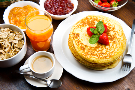 pancake: stack of freshly prepared traditional pancakes with strawberries