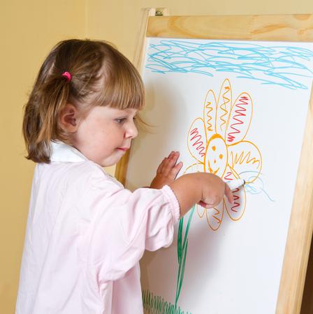 paints: little girl draws paints