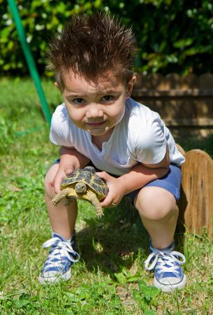 turtles love: little boy holding turtle Stock Photo