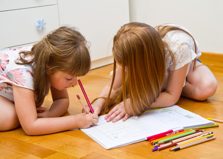 do: little girls drawing on the floor