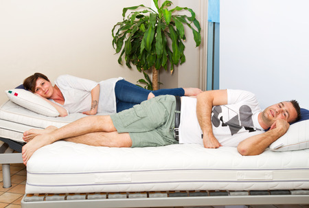resting: beautiful couple are lying on the quality mattress