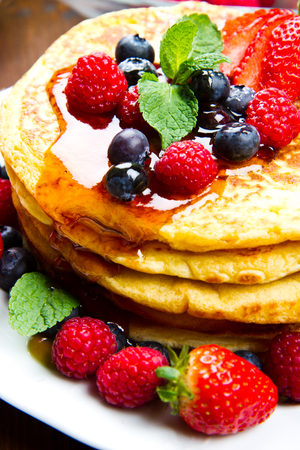 maple syrup: Pancakes with berries and maple syrup Stock Photo