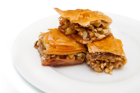 baklawa: Piece of baklava sweets on white background Stock Photo