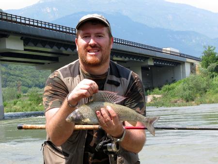 grayling: Fisherman with grayling fish