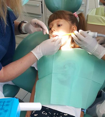 dental fear: Girl visiting the dentist