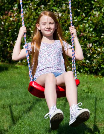 child laughing: little girl on the swing Stock Photo