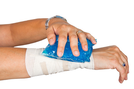 arm bands: Womans arm with bandage and ice painkiller Stock Photo