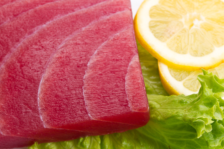 tuna sashimi with salad and lemon on white background Stock Photo