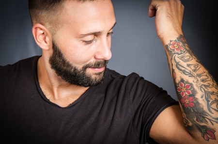 tatto: Handsome young man with tatto