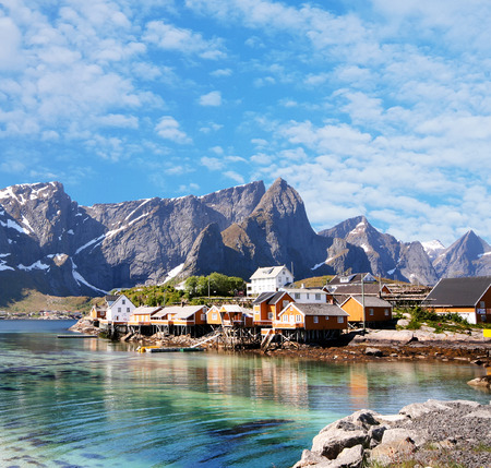 artic: small town of hamnoy near lofoten in norway with blue sky Stock Photo
