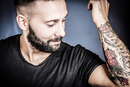 arm tattoo: Handsome young man with tatto