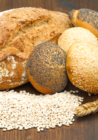 multi grain: healthy multi grain bread on wood Stock Photo