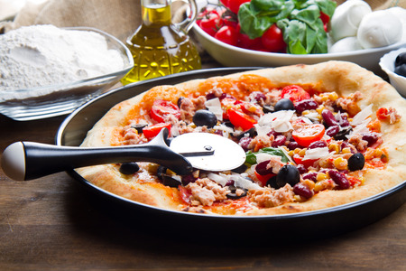 american pizza with salami,beans and mais Stock Photo