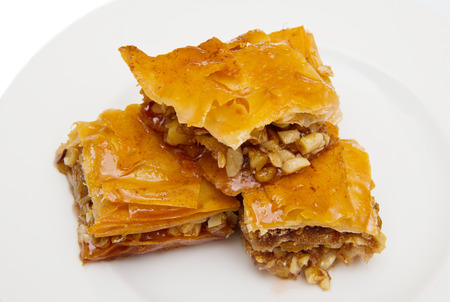 Piece of baklava sweets on white background Stock Photo