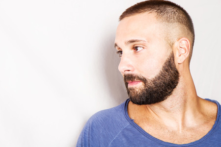 beard man: handsome young thoughtful man Stock Photo