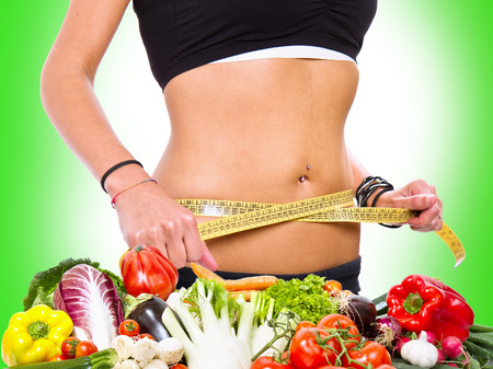 diet concept: a slim girl measuring her weight Stock Photo