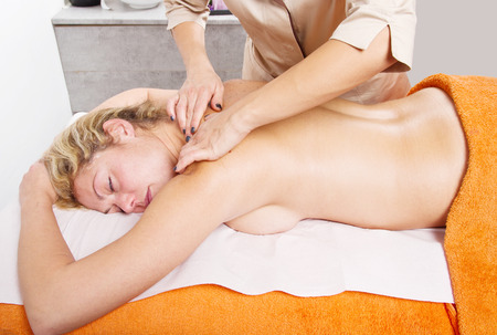 Relaxed woman having a massage in a beauty center  photo