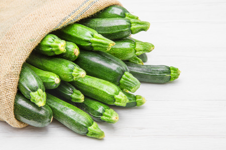 green vegetable: canvas sack full of zucchini Stock Photo