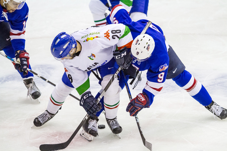 MILAN, ITALY - May 2:Andrew Copp of USA TEam and Tommaso Goi of Italian Team during a friendly game between Italy Hockey Team and USA Hockey Team in Agora Arena on May 2, 2017, in Milan Editorial