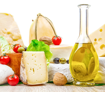Various types of cheese on white wood Stock Photo