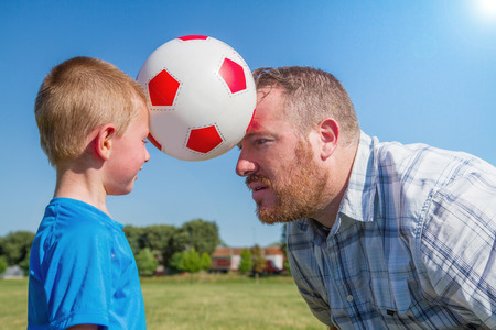 Dad and little boy play with the ball photo