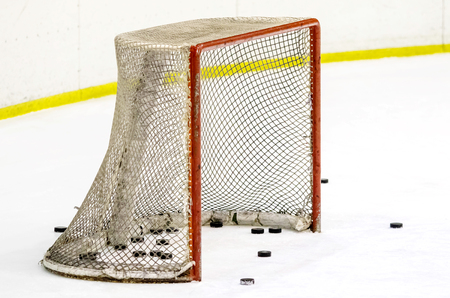hockey puck near the net