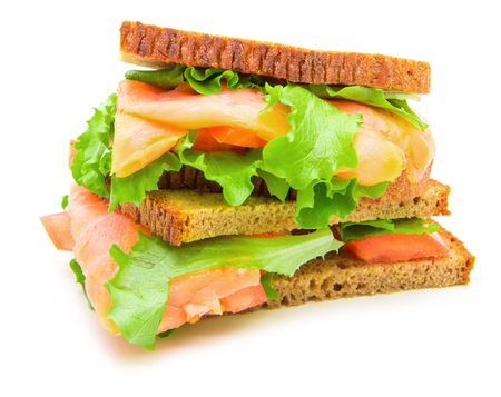 sandwich with smoked salmon,salad and lemon