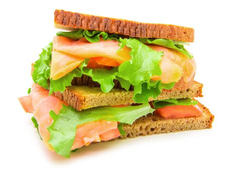 sandwich with smoked salmon,salad and lemon