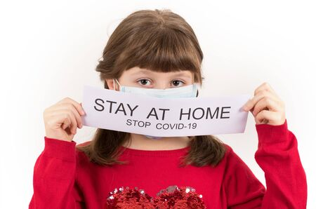 Young girl is holding poster with