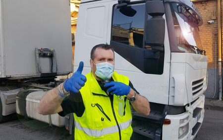 young transporter on the truck with face mask and protective gloves for Coronavirus Stock fotó