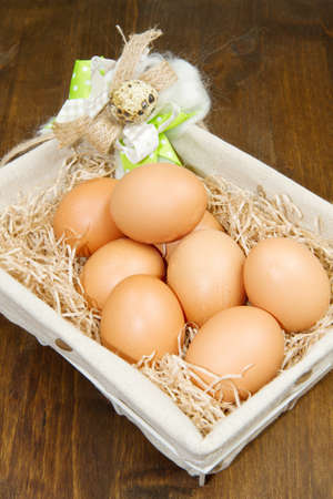 Eggs in a basket on wodden table