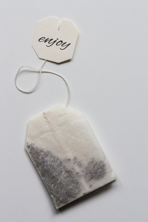 Tea bag closeup on white background