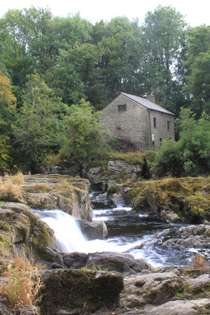 river waterfall with watermill